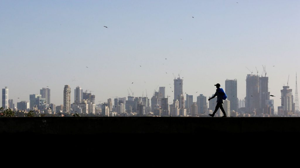 man-walking-mumbai-financial-district